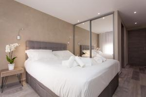 A bed or beds in a room at Palladium