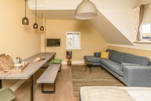 Ein Sitzbereich in der Unterkunft De Herberg Appartementen