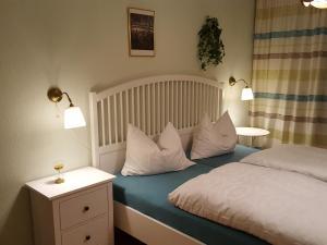 Ein Bett oder Betten in einem Zimmer der Unterkunft Ferienwohnung Valentin