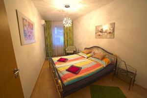 Posteľ alebo postele v izbe v ubytovaní New Buda Apartment