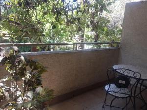 Un balcón o terraza de J&F Apartamento Santa Beatriz