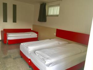 A bed or beds in a room at Casa Lampone
