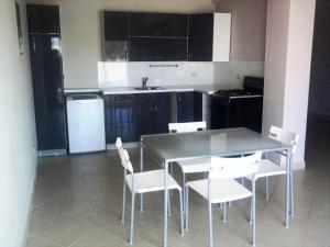 A kitchen or kitchenette at Taino Accomodation
