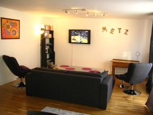Uma área de estar em Citybreak Metz Pompidou