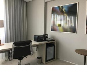 A television and/or entertainment center at Flat Paiva Home Stay