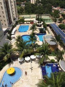 A view of the pool at Flat Prive das Thermas 2 - R3 Caldas or nearby