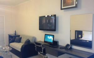 A television and/or entertainment center at Pearl Bay Hotel Apartments