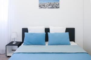 A bed or beds in a room at Apartment Nice Center Barralis