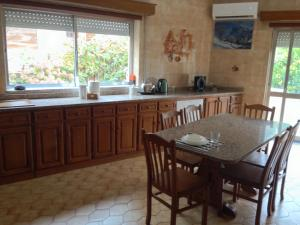 A kitchen or kitchenette at House near Fontelo