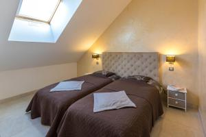 Ένα ή περισσότερα κρεβάτια σε δωμάτιο στο Holiday Home & Spa - Le Rendez Vous de Vauban