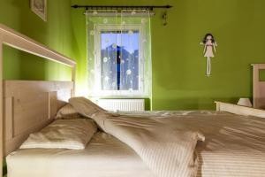 Postelja oz. postelje v sobi nastanitve Apartma Angelca