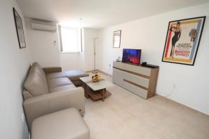 A seating area at Apartment Jacqueline