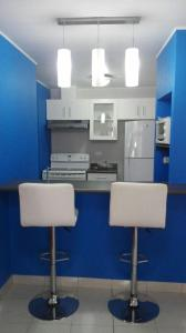 A kitchen or kitchenette at Condominios La Ronda