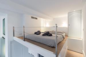 Giường trong phòng chung tại Magnificent Loft - very central
