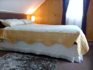 Cama o camas de una habitación en Cabanas B&S Puerto Montt