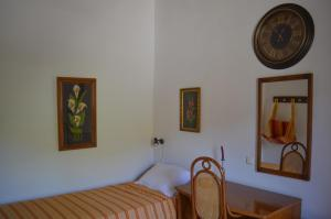 A bed or beds in a room at Epavlis Iosif