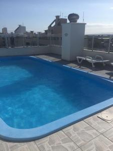 The swimming pool at or close to HANNA Jurerê Internacional Aparts
