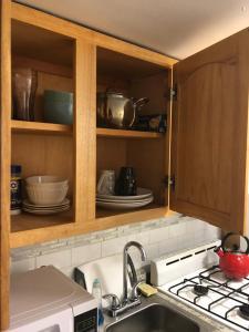 A kitchen or kitchenette at New private studio-apartment