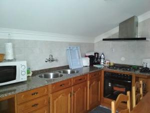 A kitchen or kitchenette at Maison Blanche
