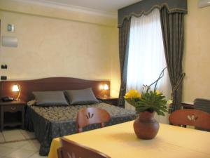 A bed or beds in a room at Residence Alberghiero Eolie