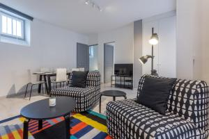 Lounge nebo bar v ubytování Grand Appartement proche Tour Eiffel