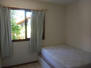 A bed or beds in a room at Areias Brancas