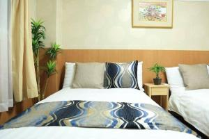 A bed or beds in a room at CC504 Akizero Apartment in Shimanouchi