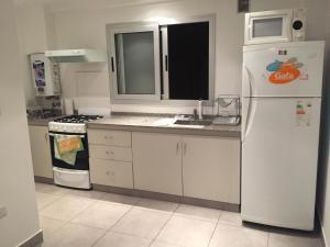 A kitchen or kitchenette at Departamento Bolivar