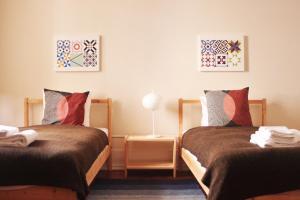 Un pat sau paturi într-o cameră la Upper Lisbon