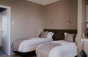 A bed or beds in a room at Black Beach Suites