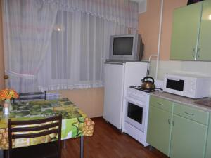 A kitchen or kitchenette at Chelny Apartments Hotel