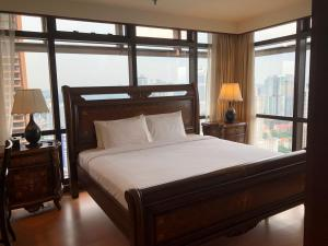 A bed or beds in a room at Bukit Bintang Suite At Times Square