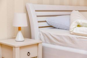 A bed or beds in a room at Zvenigorod cottage Sadovaya