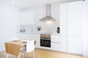 Dapur atau dapur kecil di Apartamentos San Lorenzo 26