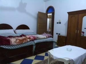 A bed or beds in a room at Luxor Legend Apartments