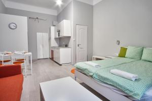 A bed or beds in a room at HILD-2 Apartments | Budapest