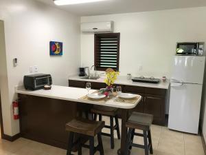 A kitchen or kitchenette at Buccaneer Beach Club