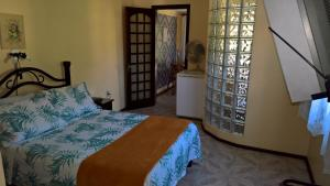 A bed or beds in a room at Angra dos Reis, Bonfim 202