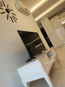 Телевизор и/или развлекательный центр в Best Home 20 Kleopatra