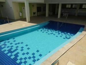 The swimming pool at or near Serra Park Flat Residence