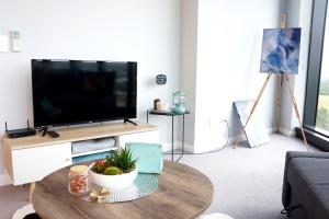 A television and/or entertainment center at Water View Apartment