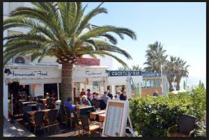 A restaurant or other place to eat at Nerja Torrecillastranden