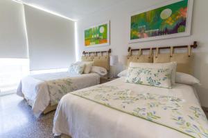 A bed or beds in a room at Apartamento Vip Edificio Calima