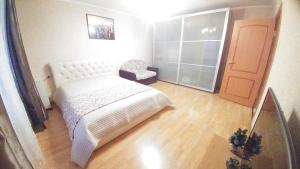 A bed or beds in a room at Apartament D&T
