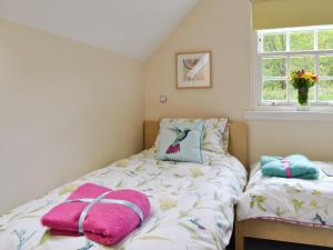 A bed or beds in a room at River Cottage