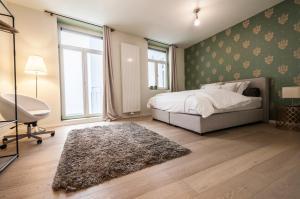 Cama ou camas em um quarto em Heart of the City