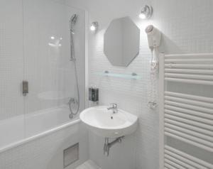 Ein Badezimmer in der Unterkunft Six Continents