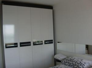 A bed or beds in a room at Varandas de Iracema 1102