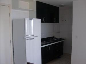 A kitchen or kitchenette at Varandas de Iracema 1102