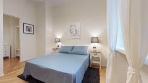 A bed or beds in a room at Duomo Luxury Apartment